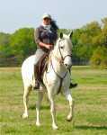 Kate riding Andante (Apple Pie de Miami) at the 2011 clinic